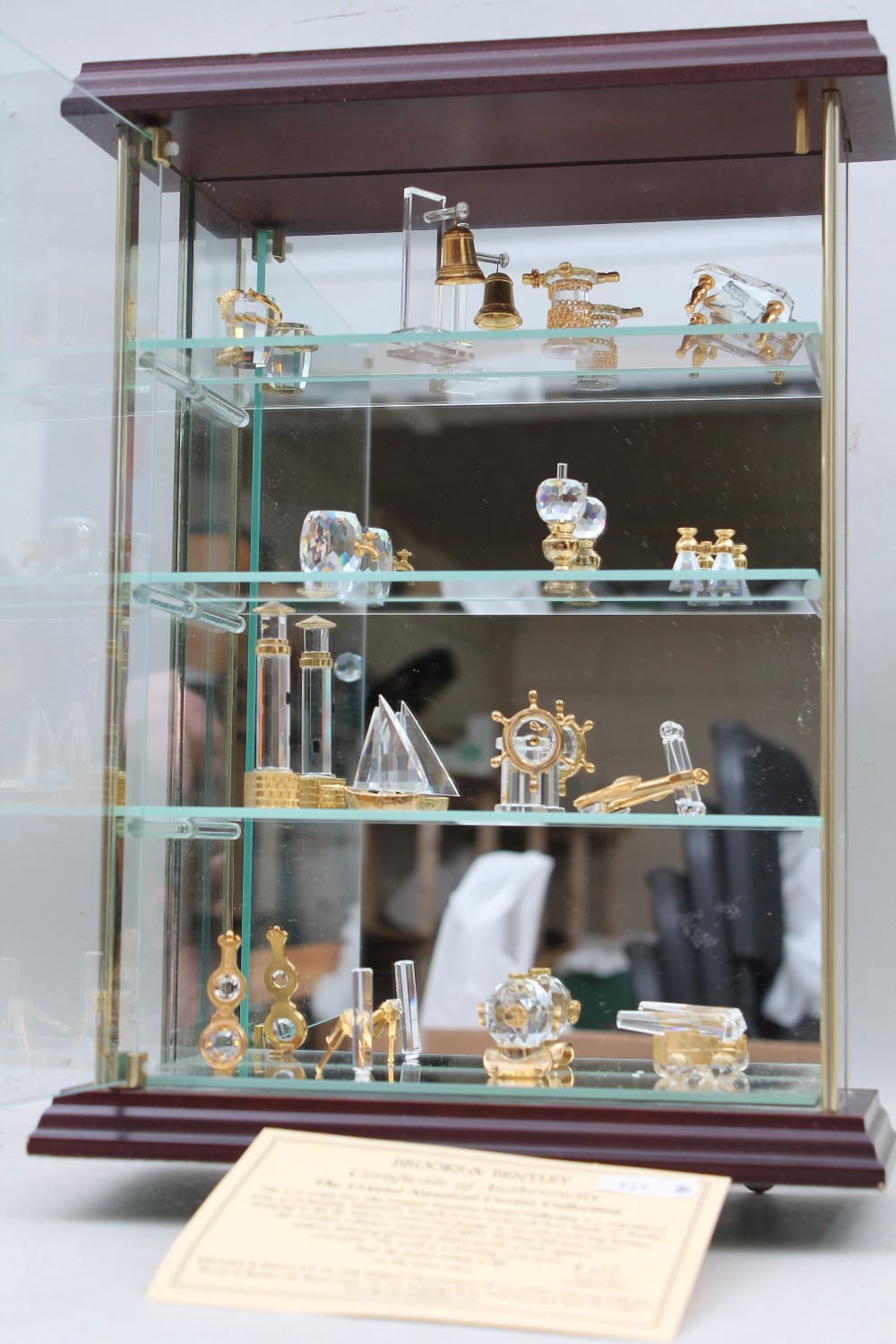 A Small Display Cabinet Containing Collection Of Brooks Bentley Within Sizing 1000 X 1500