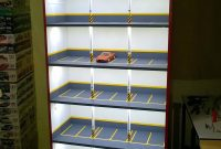 Creative Model Car Display Cabinet Looks Like Lighted Parking Garage in proportions 1152 X 2048