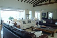 Brown Leather Sofas And White Sofa In Modern Coastal Living Room in size 1300 X 1141