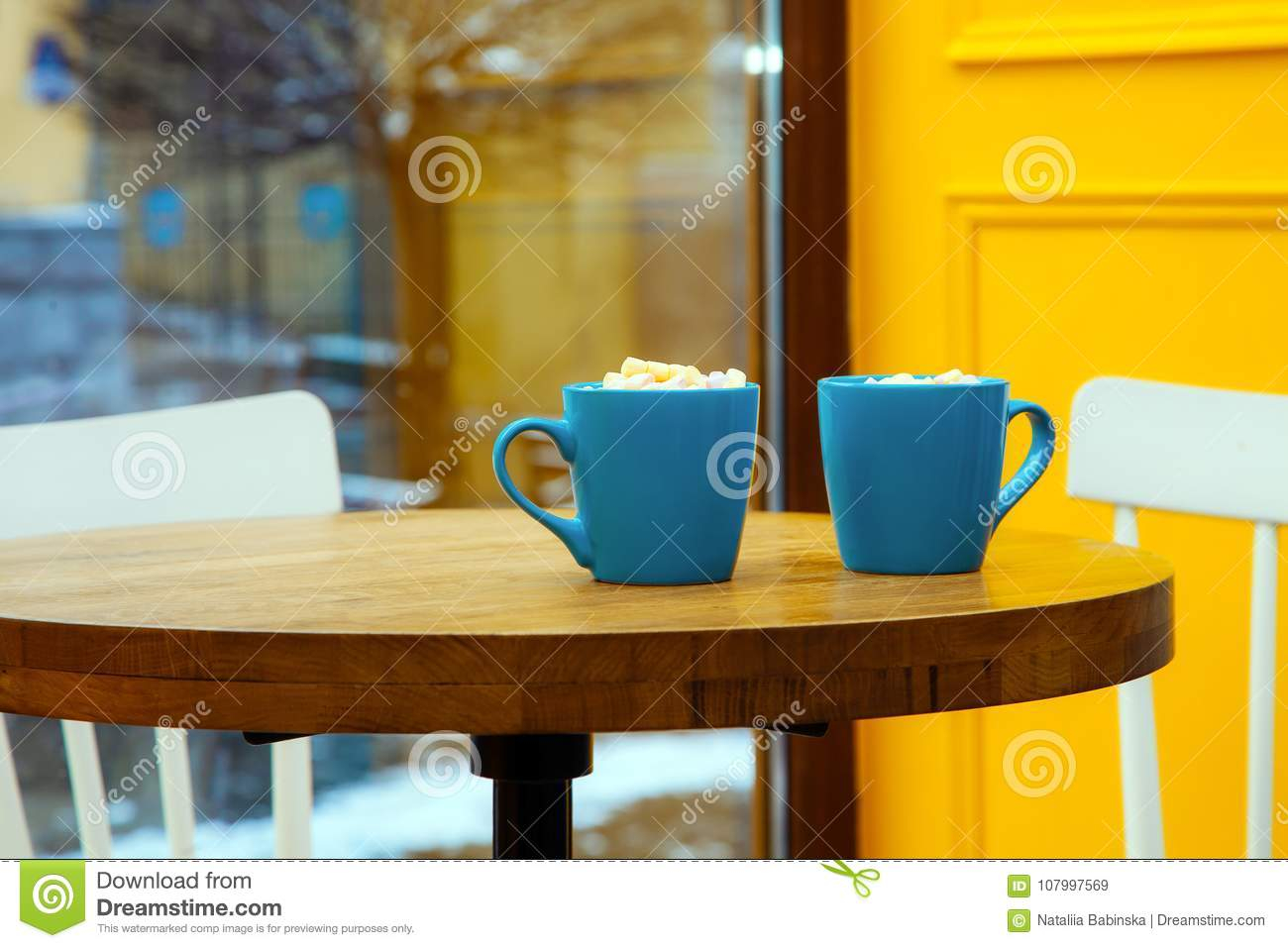 Coffee Cup Yellow Background Table Blue Chair Window Marshmallow intended for measurements 1300 X 957