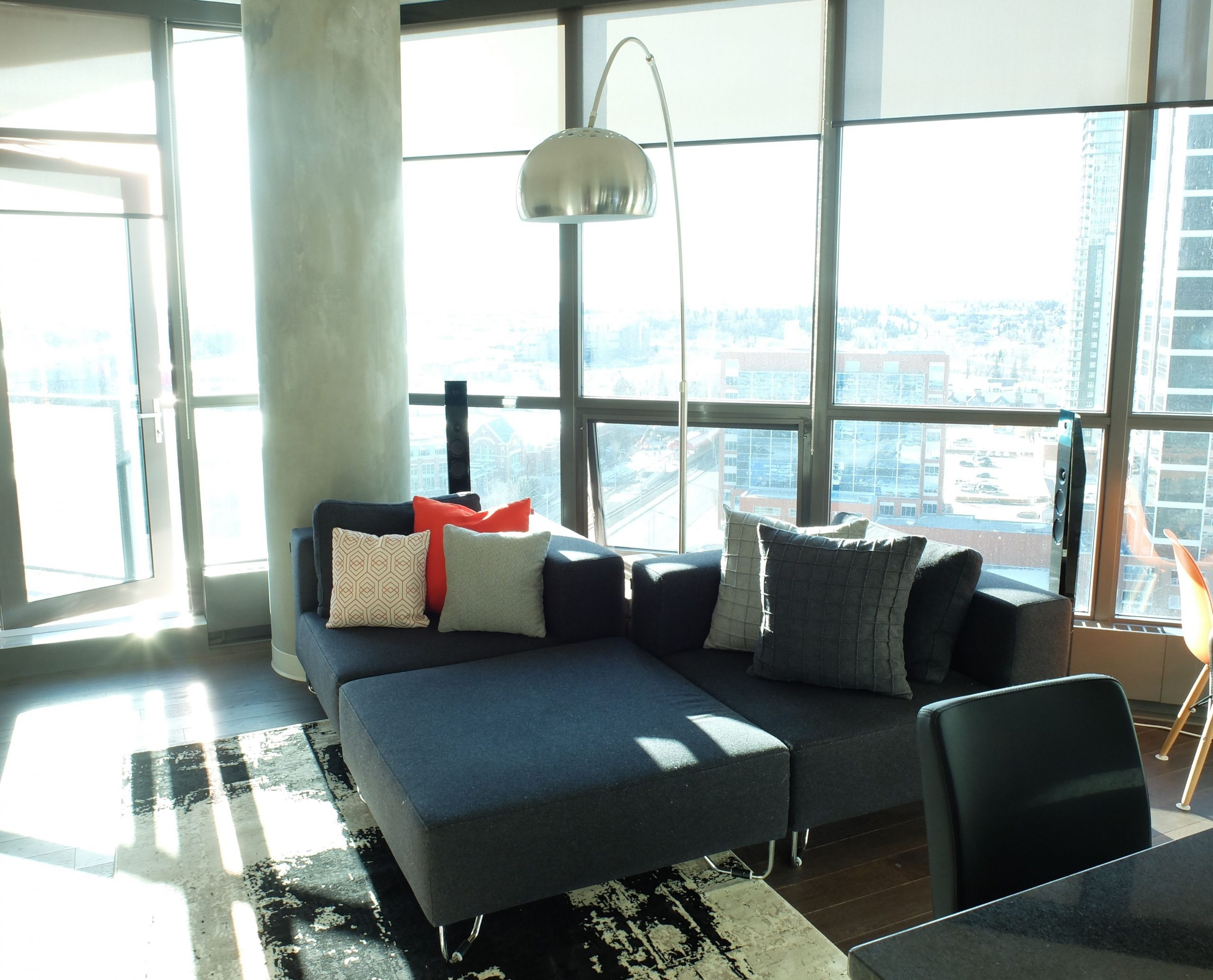 Modern Condo Living Room With Gray Low Profile Sectional intended for sizing 3714 X 3000