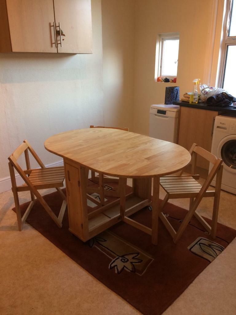 Light Oak Folding Dining Table With 4 Chairs In Herne Bay Kent Gumtree intended for sizing 768 X 1024